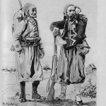 """""""Uniformen der Feinde"""". Zuaven und Turkos (nicht zu verwechseln mit Türken) waren kriegserprobte nordafrikanische Truppen der französischen Armee (vielfach Muslime), die bereits seit Mitte des 19. Jahrhunderts an französischen Kolonialkriegen beteiligt waren. Unmittelbar vor Beginn des Ersten Weltkrieges waren sie im Kriegseinsatz in Algerien. Die Schlachten des Deutsch-Französischen Krieges 1870/71 in Weißenburg (Weißenburgerstr. in Dortmund- Innenstadt) und Wörth (Wörthstr. in Dortmund-Hörde) waren zeitgenössisch auch deshalb so """"aufsehenerregend"""", weil sich hier zum ersten Mal afrikanische und deutsche Soldaten gegenüber standen."""