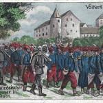 """""""Ankunft französischer Gefangener in Ingolstadt. Völkerfriede 1914"""". Ansichtskarte (Verlag Josef Huber, München), gelaufen als Feldpost im August 1915 von Ingolstadt. Sammlung Detlev Brum."""